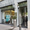 Fabrication et pose d'une devanture et d'une enseigne, d'un salon de coiffure en inox polis miroir. Verre SP10
