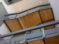 Escalier monumental sur trois niveaux en acier thermolaqué et ces garde-corps en tôle découpée au laser. Un escalier situé dans un garage automobile a Gemenos.