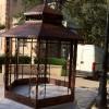 Création d'une volière en fer forgé rouillé avec partie fixe et ouvrante en cornier acier. Aix en Provence