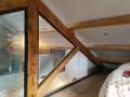 Aménagement d'une ferme bois. Châssis en corniere acier et parclose métallique. Vitrage 55/2 feuilleté. Finition teintée. Chateau- Gombert